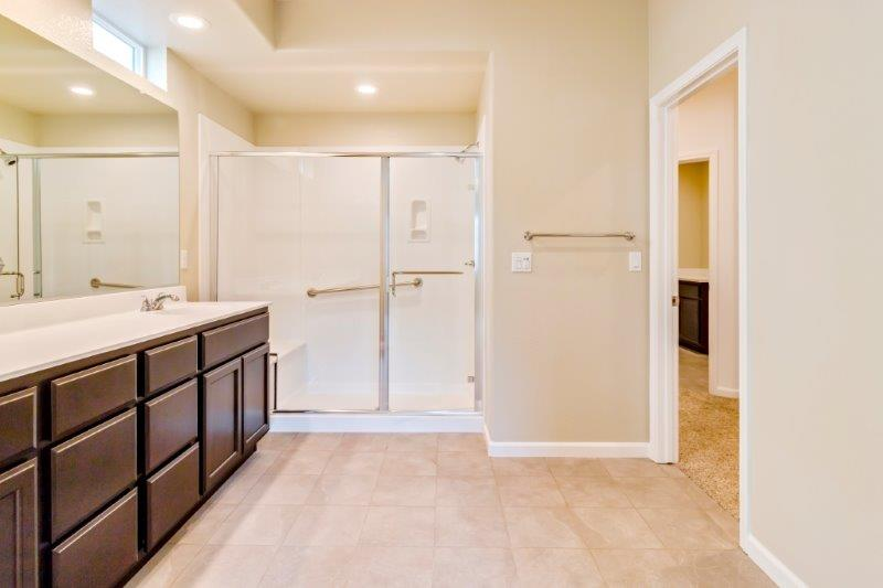 Walk-in shower with optional grab bars
