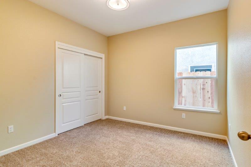 Third bedroom with included designer light fixture