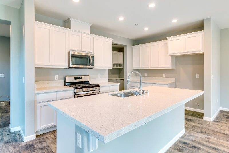 Kitchen with upgraded white painted cabinets