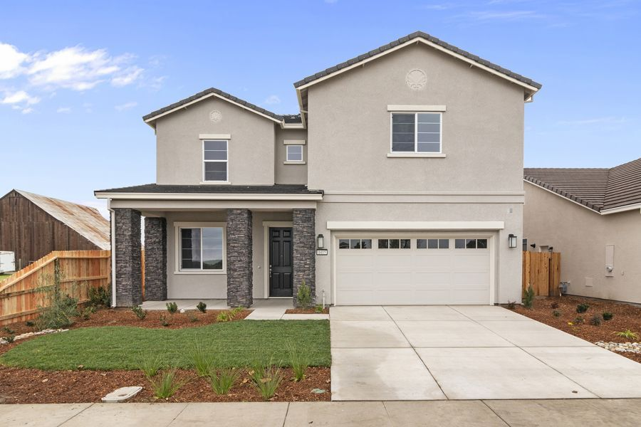 Elevation B features stone accents and a medallion
