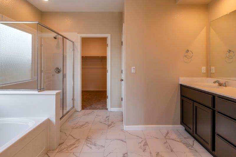 Beautiful master bath with large walk-in closet