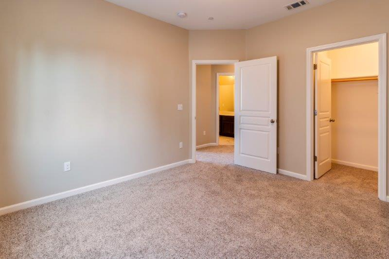 Secondary bedroom features large walk-in closet