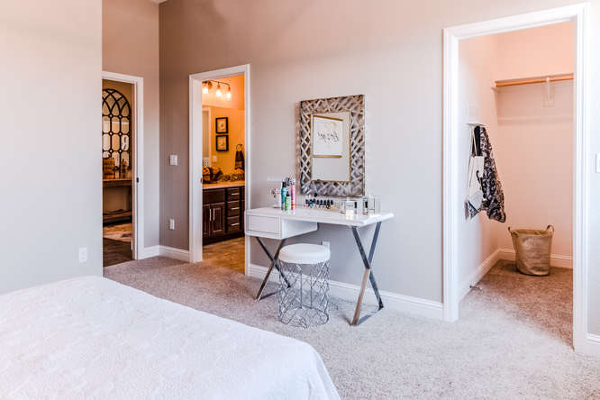 Secondary bedroom with walk-in closet