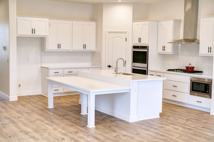 Designer white painted cabinets with black hardware