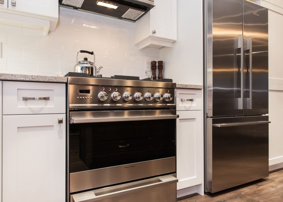 Clean Lines for this Kitchen Complete with Stainless Steel Appliances