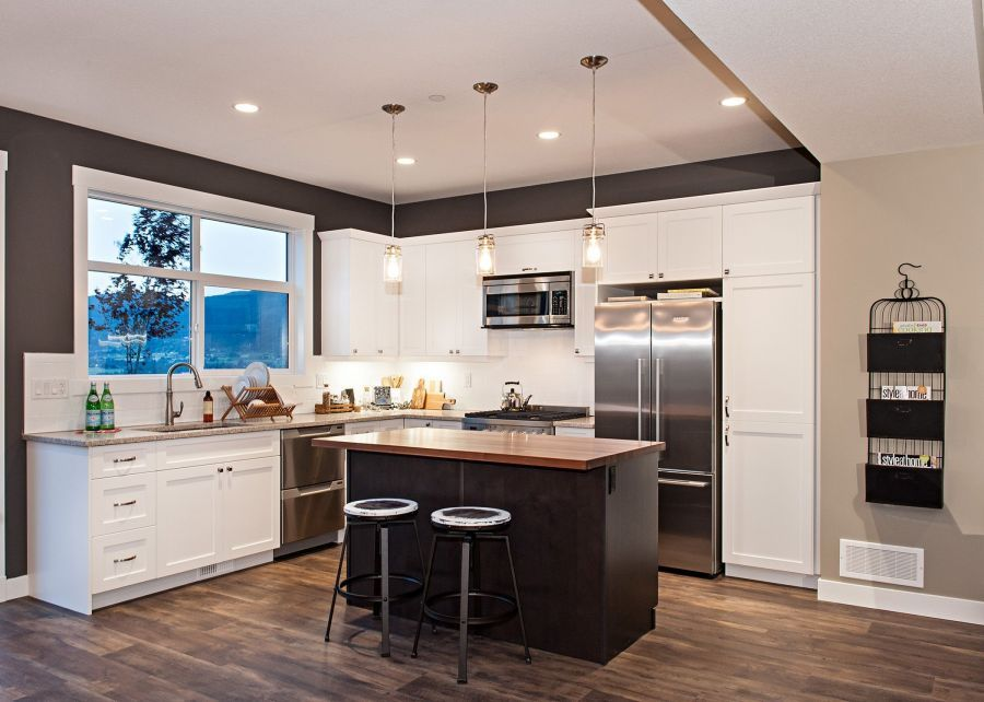 A Modern Kitchen with Butcher Block Counter Top on the Island